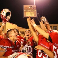 The Hoisington Cardinals celebrate with the Bi-District Champions Trophy. The Hoisington Cardinals defeated the Lakin Broncs in the KSHSAA Class 3A Bi-District game with a score of 56 to 13 at Elton Brown Field in Hoisington, Kansas on November 1, 2016. (Photo: Joey Bahr, www.joeybahr.com)