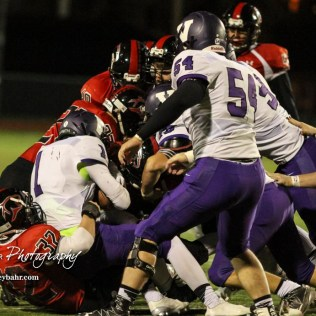 Great Bend Panther Payton Mauler (#32) pulls Valley Center Hornet Wyatt Lange (#1) backwards out of the pile. The Great Bend Panthers defeated the Valley Center Hornets to win the KSHSAA Class 5A Sectional by a score of 28 to 24 at Memorial Field in Great Bend, Kansas on November 11, 2016. (Photo: Joey Bahr, www.joeybahr.com)