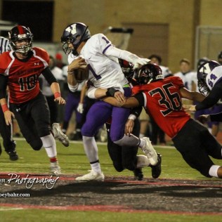 Great Bend Panther Braulio Vargas (#36) tries to pull down Valley Center Hornet Wyatt Lange (#1). The Great Bend Panthers defeated the Valley Center Hornets to win the KSHSAA Class 5A Sectional by a score of 28 to 24 at Memorial Field in Great Bend, Kansas on November 11, 2016. (Photo: Joey Bahr, www.joeybahr.com)