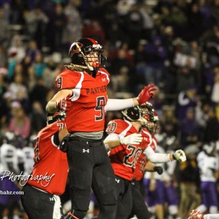 Great Bend Panther Brayden Smith (#9) celebrates as the horn sounds and they win the game. The Great Bend Panthers defeated the Valley Center Hornets to win the KSHSAA Class 5A Sectional by a score of 28 to 24 at Memorial Field in Great Bend, Kansas on November 11, 2016. (Photo: Joey Bahr, www.joeybahr.com)