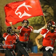 Great Bend Panther Brayden Smith (#9) carries the team flag as they take the field prior to the start of the game. The Goddard Lions defeated the Great Bend Panthers to win the KSHSAA Class 5A Sub-State Championship by a score of 50 to 21 at Memorial Field in Great Bend, Kansas on November 18, 2016. (Photo: Joey Bahr, www.joeybahr.com)