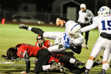 Goddard Lion Blake Sullivan (#11) flies into the air after being undercut by Great Bend Panther Max Jerke (#6). The Goddard Lions defeated the Great Bend Panthers to win the KSHSAA Class 5A Sub-State Championship by a score of 50 to 21 at Memorial Field in Great Bend, Kansas on November 18, 2016. (Photo: Joey Bahr, www.joeybahr.com)