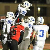 Goddard Lion AJ Vang (#51) lifts up Owen Beason (#10) in celebration of him scoring a touchdown. The Goddard Lions defeated the Great Bend Panthers to win the KSHSAA Class 5A Sub-State Championship by a score of 50 to 21 at Memorial Field in Great Bend, Kansas on November 18, 2016. (Photo: Joey Bahr, www.joeybahr.com)