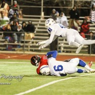 Goddard Lion Kendall Gonzalez (#6) tackles Great Bend Panther Koy Brack (#12) as Ian Mcswain (#41) takes flight. The Goddard Lions defeated the Great Bend Panthers to win the KSHSAA Class 5A Sub-State Championship by a score of 50 to 21 at Memorial Field in Great Bend, Kansas on November 18, 2016. (Photo: Joey Bahr, www.joeybahr.com)
