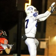 Goddard Lion Bryant Mocaby (#87) jumps for a pass in the end zone. The Goddard Lions defeated the Great Bend Panthers to win the KSHSAA Class 5A Sub-State Championship by a score of 50 to 21 at Memorial Field in Great Bend, Kansas on November 18, 2016. (Photo: Joey Bahr, www.joeybahr.com)
