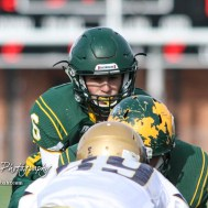 Pratt Greenback Landen Studer (#6) calls out the cadence for the play. The Pratt Greenbacks defeated the Hayden Wildcats 48 to 14 to win the KSHSAA Class 4A Division II State Championship Game at Salina Stadium in Salina, Kansas on November 26, 2016. (Photo: Joey Bahr, www.joeybahr.com)