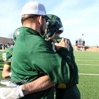 Pratt Greenback Head Coach Jamie Cruce congratulates Hunter Kaufman (#1). The Pratt Greenbacks defeated the Hayden Wildcats 48 to 14 to win the KSHSAA Class 4A Division II State Championship Game at Salina Stadium in Salina, Kansas on November 26, 2016. (Photo: Joey Bahr, www.joeybahr.com)