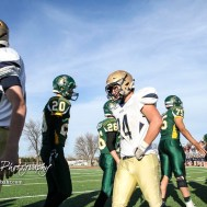 Members of the Pratt Greenbacks and the Hayden Wildcats shake hands following the game. The Pratt Greenbacks defeated the Hayden Wildcats 48 to 14 to win the KSHSAA Class 4A Division II State Championship Game at Salina Stadium in Salina, Kansas on November 26, 2016. (Photo: Joey Bahr, www.joeybahr.com)