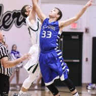 Central Plains Oiler #23 Brett Liebl and St. John Tiger #33 Chase Fisher jump for the opening tip off. The St. John Tigers defeated the Central Plains Oilers by a score of 62 to 31 at Central Plains High School in Claflin, Kansas on December 13, 2016. (Photo: Joey Bahr, www.joeybahr.com)