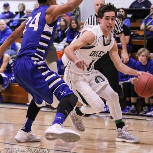 Central Plains Oiler #10 Bryce Miller drives around St. John Tiger #24 Jorge Calleros. The St. John Tigers defeated the Central Plains Oilers by a score of 62 to 31 at Central Plains High School in Claflin, Kansas on December 13, 2016. (Photo: Joey Bahr, www.joeybahr.com)