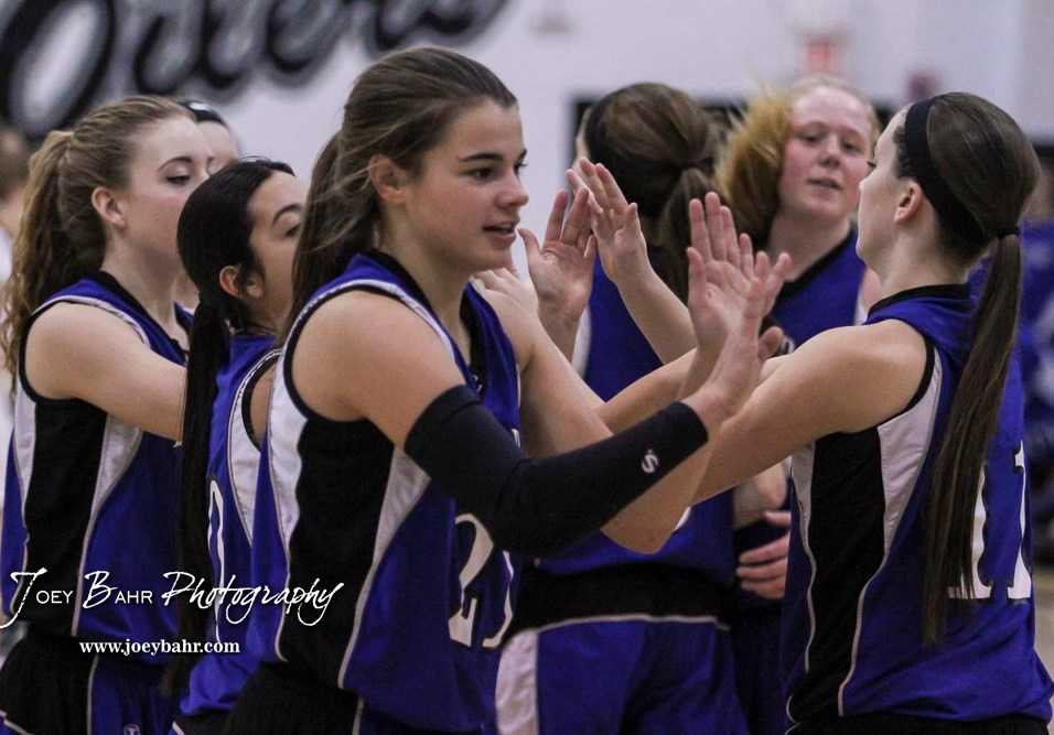 St. John Lady Tiger #21 Paige Doran greets teammates prior to the start of the game. The Central Plains Lady Oilers defeated the St. John Lady Tigers by a score of 87 to 41 at Central Plains High School in Claflin, Kansas on December 13, 2016. (Photo: Joey Bahr, www.joeybahr.com)