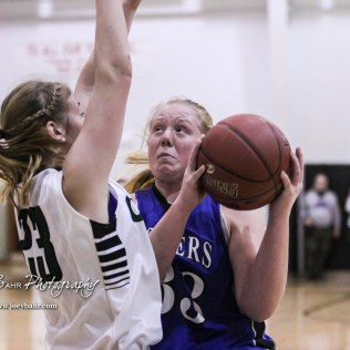 St. John Lady Tiger #33 Tara Nelson drives into Central Plains Lady Oiler #23 Kylee Kasselman. The Central Plains Lady Oilers defeated the St. John Lady Tigers by a score of 87 to 41 at Central Plains High School in Claflin, Kansas on December 13, 2016. (Photo: Joey Bahr, www.joeybahr.com)