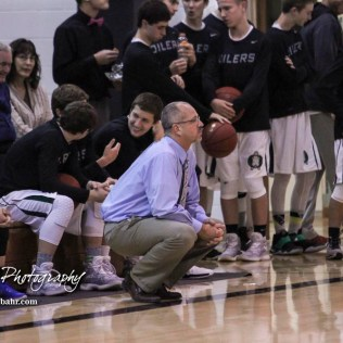 St. John Lady Tiger Head Coach Danny Smith watches a play develop. The Central Plains Lady Oilers defeated the St. John Lady Tigers by a score of 87 to 41 at Central Plains High School in Claflin, Kansas on December 13, 2016. (Photo: Joey Bahr, www.joeybahr.com)