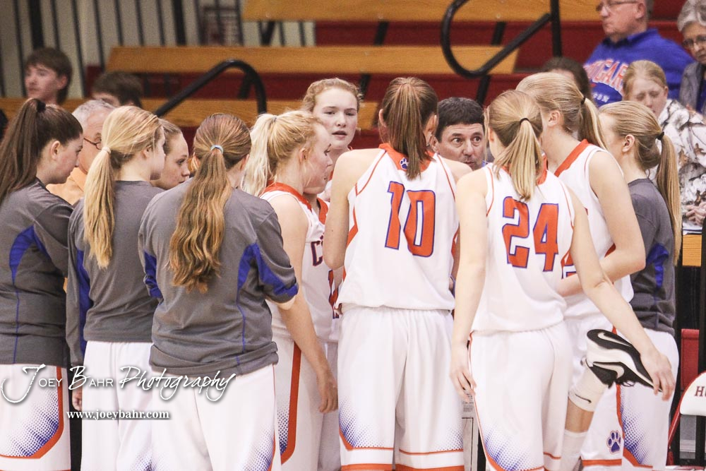 Otis-Bison Lady Cougar Head Coach Robert Trapp talks to his players before the start of the game. The Otis-Bison Lady Cougars defeated the LaCrosse Lady Leopards 61 to 55 in the Girls Semi-Final of the 2017 Hoisington Winter Jam at Hoisington Activity Center in Hoisington, Kansas on January 20, 2017. (Photo: Joey Bahr, www.joeybahr.com)