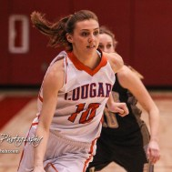 Otis-Bison Lady Cougar #10 Taylor Regan drives towards the lane. The Otis-Bison Lady Cougars defeated the LaCrosse Lady Leopards 61 to 55 in the Girls Semi-Final of the 2017 Hoisington Winter Jam at Hoisington Activity Center in Hoisington, Kansas on January 20, 2017. (Photo: Joey Bahr, www.joeybahr.com)