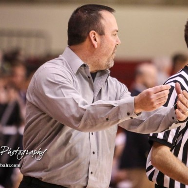 Hoisington Cardinal Head Coach Kyle Haxton talks to an official about a previous call. The Hoisington Cardinals defeated Otis-Bison Cougars 56 to 39 in the Boys Semi-Final of the 2017 Hoisington Winter Jam at Hoisington Activity Center in Hoisington, Kansas on January 20, 2017. (Photo: Joey Bahr, www.joeybahr.com)