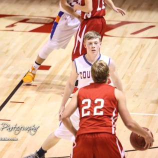Otis-Bison Cougar #1 Blake Bahr watches Hoisington Cardinal #22 Grant Dolechek dribble the ball. The Hoisington Cardinals defeated Otis-Bison Cougars 56 to 39 in the Boys Semi-Final of the 2017 Hoisington Winter Jam at Hoisington Activity Center in Hoisington, Kansas on January 20, 2017. (Photo: Joey Bahr, www.joeybahr.com)