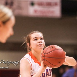 Otis-Bison Lady Cougar #15 Lacey Mitchell shoots a free throw attempt. The Otis-Bison Lady Cougars defeated the LaCrosse Lady Leopards 61 to 55 in the Girls Semi-Final of the 2017 Hoisington Winter Jam at Hoisington Activity Center in Hoisington, Kansas on January 20, 2017. (Photo: Joey Bahr, www.joeybahr.com)