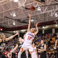 Otis-Bison Lady Cougar #10 Taylor Regan throws up a shot beneath the basket. The Otis-Bison Lady Cougars defeated the LaCrosse Lady Leopards 61 to 55 in the Girls Semi-Final of the 2017 Hoisington Winter Jam at Hoisington Activity Center in Hoisington, Kansas on January 20, 2017. (Photo: Joey Bahr, www.joeybahr.com)