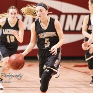 LaCrosse Lady Leopard #5 Abbey Oborny drives down the court with the ball. The Otis-Bison Lady Cougars defeated the LaCrosse Lady Leopards 61 to 55 in the Girls Semi-Final of the 2017 Hoisington Winter Jam at Hoisington Activity Center in Hoisington, Kansas on January 20, 2017. (Photo: Joey Bahr, www.joeybahr.com)