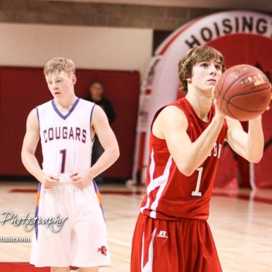 Hoisington Cardinal #1 Brenner Donovan shoots a free throw attempt. The Hoisington Cardinals defeated Otis-Bison Cougars 56 to 39 in the Boys Semi-Final of the 2017 Hoisington Winter Jam at Hoisington Activity Center in Hoisington, Kansas on January 20, 2017. (Photo: Joey Bahr, www.joeybahr.com)