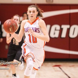 Otis-Bison Lady Cougar #10 Taylor Regan drives down the court with the ball. The Otis-Bison Lady Cougars defeated the LaCrosse Lady Leopards 61 to 55 in the Girls Semi-Final of the 2017 Hoisington Winter Jam at Hoisington Activity Center in Hoisington, Kansas on January 20, 2017. (Photo: Joey Bahr, www.joeybahr.com)