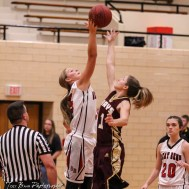 Great Bend Lady Panther #5 Camryn Dunekack and Hays Lady Indian #1 Talyn Kleweno jump for the opening tip off. The Great Bend Lady Panthers defeated the Hays Lady Indians by a score of 54 to 41 at Great Bend High School in Great Bend, Kansas on January 10, 2017. (Photo: Joey Bahr, www.joeybahr.com)