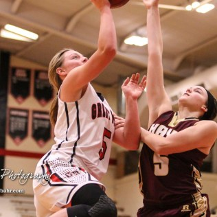 Hays Lady Indian #5 Jaycee Dale tries to block a shot by Great Bend Lady Panther #5 Camryn Dunekack. The Great Bend Lady Panthers defeated the Hays Lady Indians by a score of 54 to 41 at Great Bend High School in Great Bend, Kansas on January 10, 2017. (Photo: Joey Bahr, www.joeybahr.com)