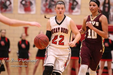 Great Bend Lady Panther #22 Carley Brack drives past Hays Lady Indian #10 Tasiah Nunnery. The Great Bend Lady Panthers defeated the Hays Lady Indians by a score of 54 to 41 at Great Bend High School in Great Bend, Kansas on January 10, 2017. (Photo: Joey Bahr, www.joeybahr.com)