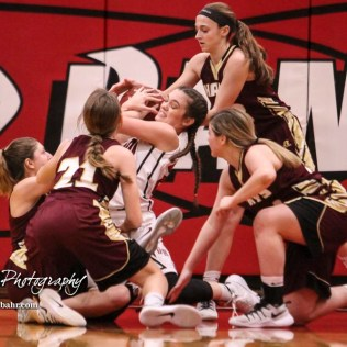 The Hays Lady Indians surround a loose ball as Great Bend Lady Panther #25 Carly Dreiling tries to pull it in. The Great Bend Lady Panthers defeated the Hays Lady Indians by a score of 54 to 41 at Great Bend High School in Great Bend, Kansas on January 10, 2017. (Photo: Joey Bahr, www.joeybahr.com)