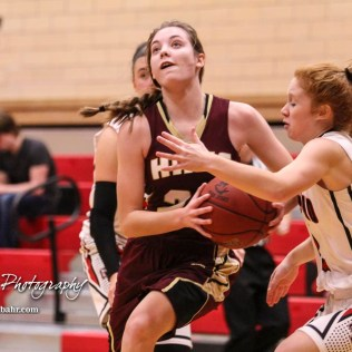 Hays Lady Indian #21 Savannah Schneider drives past Great Bend Lady Panther #2 Keely Ireland. The Great Bend Lady Panthers defeated the Hays Lady Indians by a score of 54 to 41 at Great Bend High School in Great Bend, Kansas on January 10, 2017. (Photo: Joey Bahr, www.joeybahr.com)