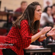 Great Bend Lady Panther Head Coach Carrie Minton cheers a successful defensive play. The Great Bend Lady Panthers defeated the Hays Lady Indians by a score of 54 to 41 at Great Bend High School in Great Bend, Kansas on January 10, 2017. (Photo: Joey Bahr, www.joeybahr.com)