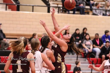 Great Bend Lady Panther #25 Carly Dreiling tries to block a shot by Hays Lady Indian #43 Maddie Keller. The Great Bend Lady Panthers defeated the Hays Lady Indians by a score of 54 to 41 at Great Bend High School in Great Bend, Kansas on January 10, 2017. (Photo: Joey Bahr, www.joeybahr.com)