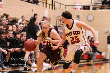 Hays Lady Indian #21 Savannah Schneider tries to fend off Great Bend Lady Panther #25 Carly Dreiling as she drives down the court. The Great Bend Lady Panthers defeated the Hays Lady Indians by a score of 54 to 41 at Great Bend High School in Great Bend, Kansas on January 10, 2017. (Photo: Joey Bahr, www.joeybahr.com)