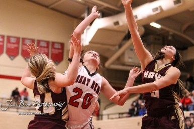 Great Bend Lady Panther #20 Brooklyn Burkhart goes for a layup as Hays Lady Indians #24 Mattie Hutchinson and #5 Jaycee Dale defend. The Great Bend Lady Panthers defeated the Hays Lady Indians by a score of 54 to 41 at Great Bend High School in Great Bend, Kansas on January 10, 2017. (Photo: Joey Bahr, www.joeybahr.com)