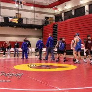 Members of the Lincoln and Plainville wrestling teams shake hands following the end of their Team Dual. The Hoisington Cardinal Duals were held at the Hoisington Activity Center in Hoisington, Kansas on January 12, 2017. (Photo: Joey Bahr, www.joeybahr.com)