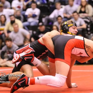 Jonathan Ball (Hoisington) runs Tristan Porsch (Hoxie) in their weight class 145 semi-final.The KSHSAA Class 321A State Wrestling Championships were held at Gross Memorial Coliseum on the campus of Fort Hays State University in Hays, Kansas on February 24, 2017. (Photo: Joey Bahr, www.joeybahr.com)