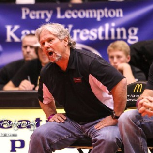 Hoisington Head Coach Dan Schmidt calls out to Jonathan Ball during the weight class 145 semi final. The KSHSAA Class 321A State Wrestling Championships were held at Gross Memorial Coliseum on the campus of Fort Hays State University in Hays, Kansas on February 24, 2017. (Photo: Joey Bahr, www.joeybahr.com)