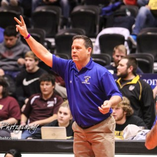 Norton Head Coach Bill Johnson holds up two fingers in calling for two points in the weight class 152 semi-final. The KSHSAA Class 321A State Wrestling Championships were held at Gross Memorial Coliseum on the campus of Fort Hays State University in Hays, Kansas on February 24, 2017. (Photo: Joey Bahr, www.joeybahr.com)