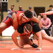 Taye Washington (Hoxie) looks to the official as he holds Landen Urban (Hoisington) in the weight class 285 semi-final. The KSHSAA Class 321A State Wrestling Championships were held at Gross Memorial Coliseum on the campus of Fort Hays State University in Hays, Kansas on February 24, 2017. (Photo: Joey Bahr, www.joeybahr.com)