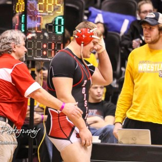 Hoisington Head Coach Dan Schmidt congratulates Landen Urban for his third place victory in weight class 285. The KSHSAA Class 321A State Wrestling Championships were held at Gross Memorial Coliseum on the campus of Fort Hays State University in Hays, Kansas on February 25, 2017. (Photo: Joey Bahr, www.joeybahr.com)