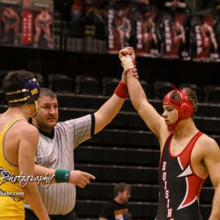 An official raises Christopher Ball's (Hoisington) hand. Ball won the match and weight class 152 with a pin fall at 1:31 into the match. The KSHSAA Class 321A State Wrestling Championships were held at Gross Memorial Coliseum on the campus of Fort Hays State University in Hays, Kansas on February 25, 2017. (Photo: Joey Bahr, www.joeybahr.com)