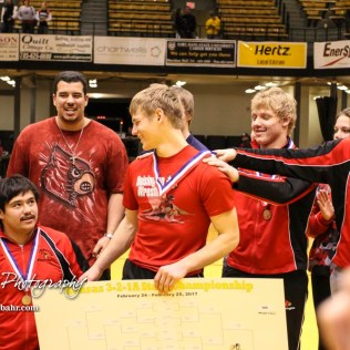 Teammates congratulate Jonathan Ball on winning the Outstanding Senior Wrestler award. The KSHSAA Class 321A State Wrestling Championships were held at Gross Memorial Coliseum on the campus of Fort Hays State University in Hays, Kansas on February 25, 2017. (Photo: Joey Bahr, www.joeybahr.com)