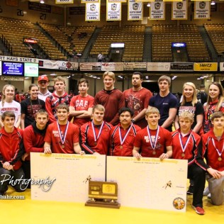 The Hoisington Cardinals line up for a picture with the State Runner-up Trophy. The KSHSAA Class 321A State Wrestling Championships were held at Gross Memorial Coliseum on the campus of Fort Hays State University in Hays, Kansas on February 25, 2017. (Photo: Joey Bahr, www.joeybahr.com)