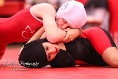 Cassidy Anderson (Caney Valley) tries to turn Natalie Garza (Great Bend) on to her back. Anderson won the match by fall. The first ever Kansas High School Girls Wrestling Championship was held at the Roundhouse at McPherson High School in McPherson, Kansas on February 11, 2017. (Photo: Joey Bahr, www.joeybahr.com)