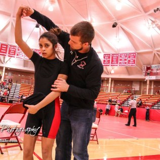 Great Bend Wrestling Coach Nathan Brockelman talks to Natalie Garza after her match. The first ever Kansas High School Girls Wrestling Championship was held at the Roundhouse at McPherson High School in McPherson, Kansas on February 11, 2017. (Photo: Joey Bahr, www.joeybahr.com)