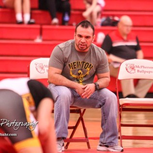 Newton wrestling coach Tommy Edgmon talks to Delany Cowden during her match. The first ever Kansas High School Girls Wrestling Championship was held at the Roundhouse at McPherson High School in McPherson, Kansas on February 11, 2017. (Photo: Joey Bahr, www.joeybahr.com)