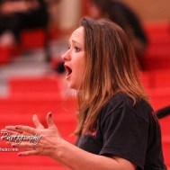 The mother of Osawatomie wrestler Amanda Newcomb shouts encouragement to her daughter from the stands. The first ever Kansas High School Girls Wrestling Championship was held at the Roundhouse at McPherson High School in McPherson, Kansas on February 11, 2017. (Photo: Joey Bahr, www.joeybahr.com)
