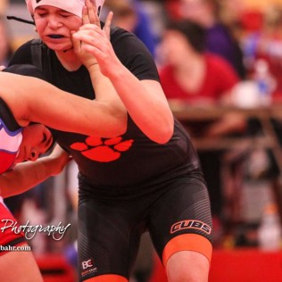 Mariyah Reyes (Dodge City) pushes back Cheyenne Harris (Humboldt). Reyes won the match by fall. The first ever Kansas High School Girls Wrestling Championship was held at the Roundhouse at McPherson High School in McPherson, Kansas on February 11, 2017. (Photo: Joey Bahr, www.joeybahr.com)