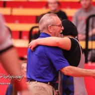 Lincoln Wrestling Coach John Gardner hugs Tia Hayworth after she won her match by fall. The first ever Kansas High School Girls Wrestling Championship was held at the Roundhouse at McPherson High School in McPherson, Kansas on February 11, 2017. (Photo: Joey Bahr, www.joeybahr.com)